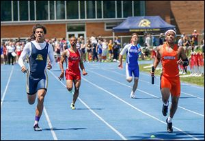 Malcolm Johnson, right, helps Southview win the 800-meter relay. He also won the 100, 200, and was on the winning 400-relay team.