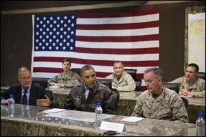 President Barack Obama, center, is briefed by Marine General Joseph Dunford, commander of the US-led International Security Assistance Force (ISAF), right, and US Ambassador to Afghanistan James Cunningham.