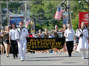The Sylvania Northview High School bBand, lead by drum majors Luke Bushrow, a senior, left, and Claire Goecke, a junior.