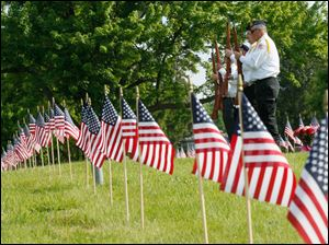 Before the parade, the city hosted a ceremony at Toledo Memorial Park in Section 6, the veterans' section.