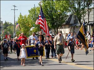 Boy and Girl Scout troops, local politicians, motorcyclists and antique cars were part of this year's parade.