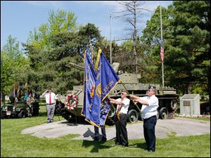 Dave McVey, of Joseph Diehn American Legion Post 468, left, salutes during the posting of the  colors. The color guard personnel are,  John E. Schuster, left, and John A. Nye, both members of VFW Remagen Bridge Post 3717, and Joe Navarre, of American Legion Joseph W. Diehn Post 468.