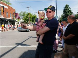 Jeff Robinson, of Sylvania Township, with his daughter Kathryn, 11 months.