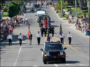 The parade is lead by a Sylvania Police vehicle and a color guard with members from the American Legion Joseph W. Diehn Post 468 and the Veterans of Foreign Wars Remagen Bridge Post 3717.
