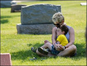 Patricia Gaffney, with son Alexander Gaffney, 4, of Perrysburg, bows her head in prayer.