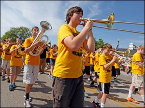 Aaron Polaff, 13, center, plays his trombone with the Perrysburg Junior High School band.