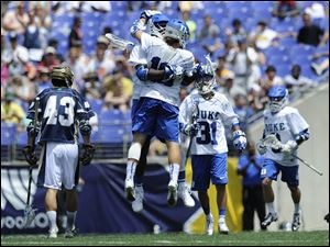 Duke's Myles Jones, center rear, and Deemer Class, center foreground, celebrate a goal against Notre Dame in the first half.