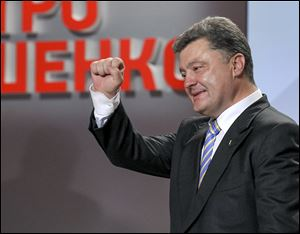 An exit poll showed that billionaire candy-maker Petro Poroshenko won Ukraine's presidential election outright Sunday in the first round — a vote that authorities hoped would unify the fractured nation.