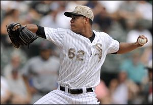 Chicago White Sox starter Jose Quintana delivers a pitch during the first inning.