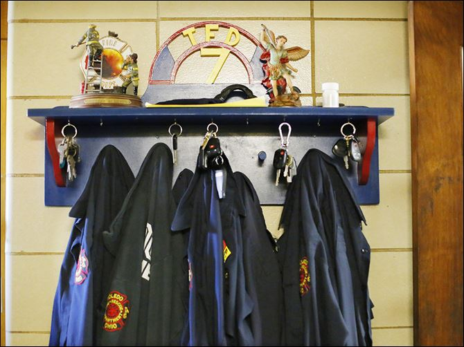 27n3tfd-1 Firefighters' shirts and keys hang on a rack at Toledo Fire Department's Station 7, 2155 Franklin St.