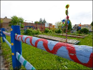 Colorfully painted objects such as this split rail fence are a hallmark.