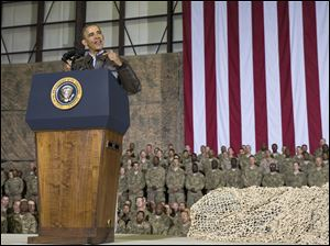 President Obama speaks during a troop rally after arrivin