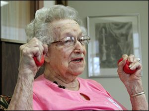 Hildegard Gigl leads a twice weekly exercise class at Hawthorne Terrace independent retirement center in Wauwatosa, Wis. Ms. Gigl, who turns 99 in June, is the oldest in the class. 'I'm getting older but I'm not getting old,' she says.