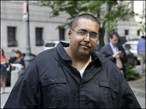 Hector Xavier Monsegur arrives at court in New York for a sentencing hearing Tuesday. Monsegur, a prolific computer hacker who infiltrated the servers of major corporations, later switched sides to helped the U.S. government disrupt hundreds of cyberattacks on Congress, NASA and other sensitive targets, according to federal prosecutors.
