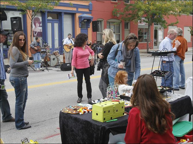CTY warehouse15p WANDER People enjoy the 9th annual Wander the Warehouse District in downtown Toledo last September.