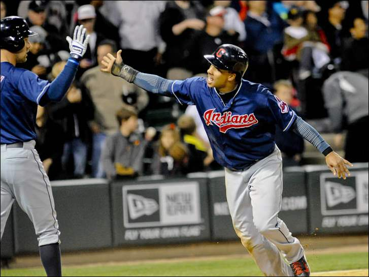 Cleveland Indians' Michael Brantley, right, greets teammate David Murphy (7) after he scores in the 9th inning.
