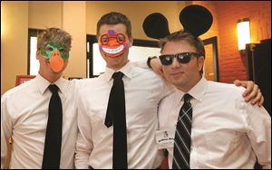 From left, attorneys Nic Linares, Ben Timmerman, and Andy McCarthy have fun at the Gridiron pre-show reception.