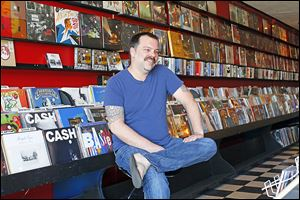 Rob Kimple, owner of RamaLama Records, in his shop.
