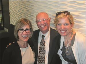 From left, Janine Avila, Bob Hawker, and Shelly Musshel- Kennedy attend the Pre-Gridiron party.