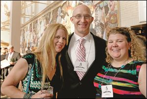 Jeni Belt, 2013 Order of the Heel, left, with Justin Burnard and Sarah Skow, co-presidents of the Toledo Junior Bar Association.