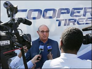 Roy Armes, Cooper Tire & Rubber Co.'s chief executive officer, discusses the tiremaker's plans after meeting employees during Cooper's 100th anniversary celebration at it Findlay headquarters.
