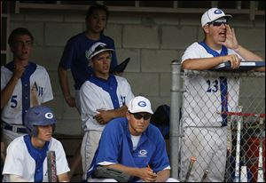 Anthony Wayne pitcher Mason Zimmerman (23), right, cheers from the dug out during a game.