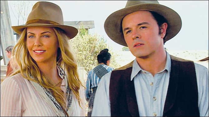 Charlize Theron and Seth MacFarlane in a scene from 'A Million Ways to Die in the West.'