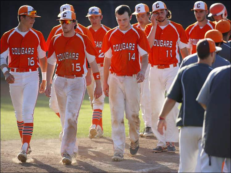 Dejected Southview players walk off the field after falling to North Royalton 3-1 during the Division I regional final.