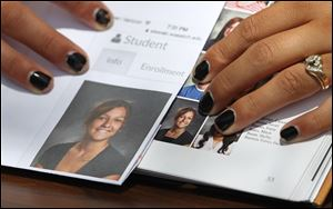 Wasatch High School sophomore Shelby Baum, 16, points to yearbook proof, left, and her altered school yearbook photo, right, in Heber City, in Utah