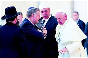 Pope Francis talks with, from left, Rabbi of the Western Wall Shmuel Rabinovitch, Argentine Rabbi Abraham Skorka, and Argentine Muslim leader Omar Abboud, during his visit at the Western Wall.