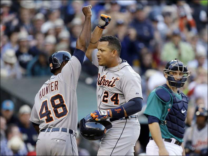 Detroit Tigers' Miguel Cabrera (24) is congratulated by teammate Torii Hunter after hitting a two-run home run.