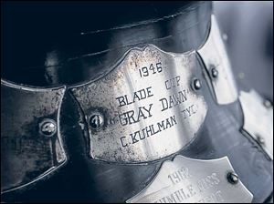 Engraving plates cover the base of The Toledo Blade Trophy, also called the Blade Cup.