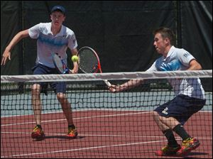 Ryan Brown returns a shot against Sycamore as his brother watches during the Ohio High School Boy's Div. I State Tennis Doubles  Championships.Sycamore won the match 6-3, 6-3.