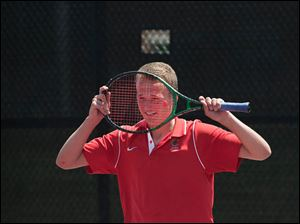 Dugan Delp reacts missing a shot against Aaron Sandberg of Walsh Jesuit at the Ohio High School Boy's Div. I State Tennis consolation match Saturday,