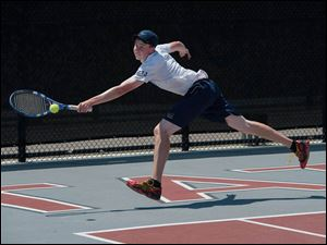Kevin Brown of St. John's Jesuit, reaches for a shot  during the Ohio High School Boy's Div. I State Tennis Doubles  Championship match against Sycamore. Sycamore won the match 6-3, 6-3.