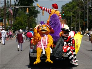 McDonalds' mascots wave during the Point Place Days parade.