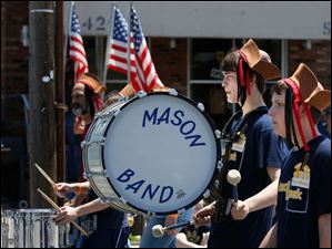Members of the Mason Band march.