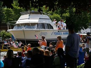 Boaters from Lost Peninsula Marina participate in the parade.