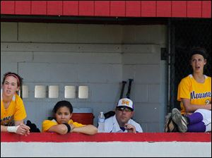 Maumee players watch the action from the dugout.