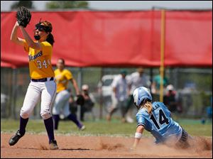 Lima Bath's Jenna Hollar (14) steals second base against Maumee's Emily Young.