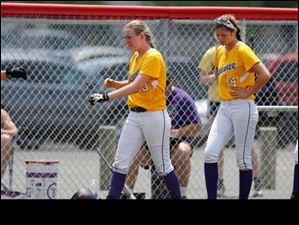 Maumee players react to their loss against Lima Bath during the Division II regional softball final.