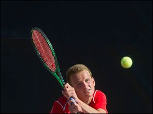 Dugan Delp returns his shot against Zach Berry of Springboro during their semi-final match.