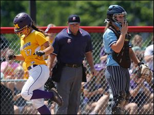 Maumee's Samantha Fowler scores against  Lima Bath during the first inning.