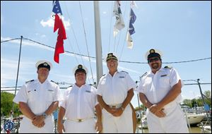 Commodores, from left: Jay Crum of Maumee River Yacht Club, Dan Maenle of Toledo Sailing Club, Tom Kaintz of Toledo Yacht Club, and Mark Gensler of Bay View Yacht Club enjoy the beautiful day during the Opening of the Port.