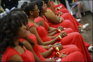 Debutantes-in-waiting watch the presentations during the Debutantes Cotillion presented by Negro Business and Professional Women.