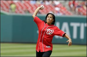National Security Adviser Susan Rice throwing out the ceremonial first pitch before a baseball game between the New York Mets and the Washington Nationals at Nationals Park in Washington.