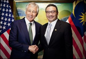 U.S. Defense Secretary Chuck Hagel, left, meets with Malaysian Defense Minister Hishammuddin Hussein today in Singapore.