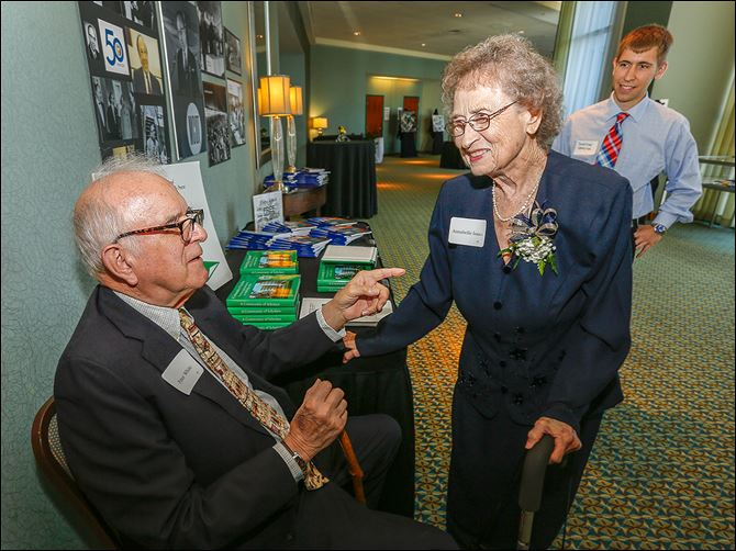 01n1peter Dr. Peter White, left, professor emeritus, chats with Annabelle Isaacs, the first employee at the Medical College of Ohio, during the 50th anniversary celebration of its founding. At right is medical student Jonathan Demeter of Springfield, Ohio.