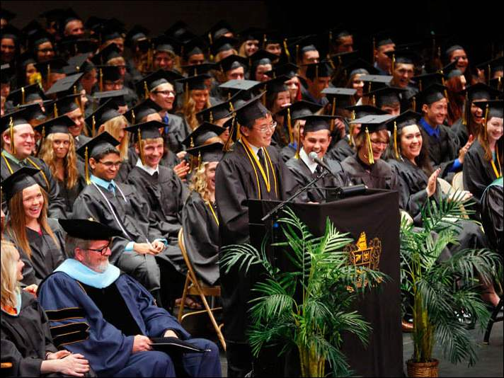 Alexander Leong gives his Valedictorian address during the 149th annual commencement ceremony for the Perrysburg High School class of 2014.
