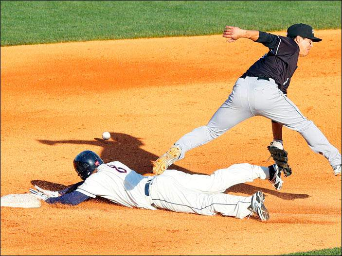 The Mud Hens' Ezequiel Carrera is safe at second after Charlotte's Tyler Saladino misses the throw.